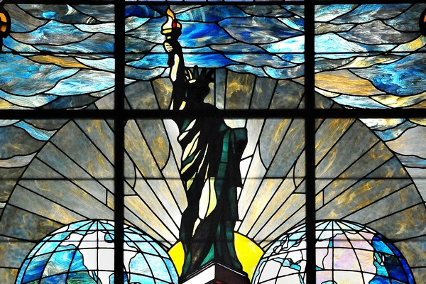 The only known remaining piece of the Pulitzer Building is this stained glass window, now in the World Room at the Columbia School of Journalism. The Pulitzer Prize committee meets in the room (Photo credit: Columbia University School of Journalism)